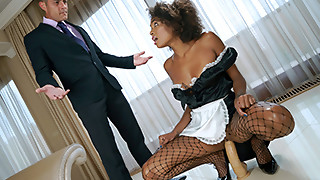 Sensual ebony maid is sucking a huge white dick with passion