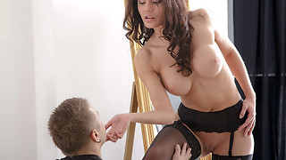 Excellent model in black lingerie gives a good blowjob