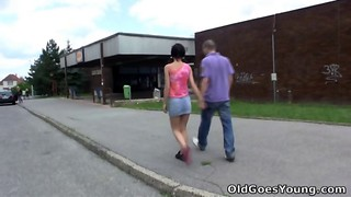 Beautiful dark-haired cutie is fucking with an old man
