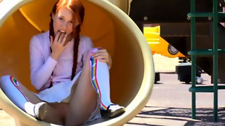 An innocent redhead teen is stuffing her snatch